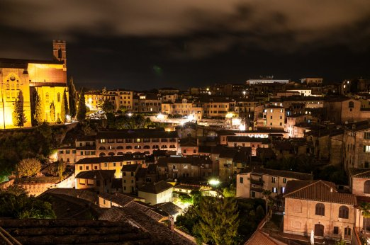 Night shot view from bedroom window towards the Basilica of San Domenico, also known as Basilica Cateriniana, Siena